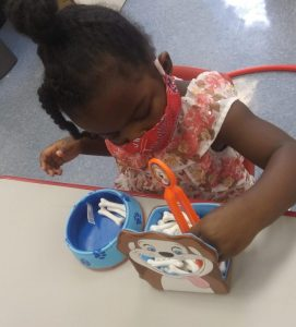 Kennedy doing an activity in class at CentroNía.